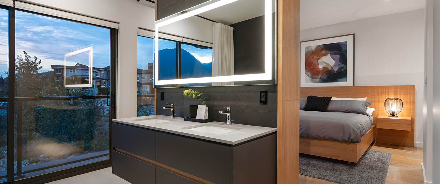 Ensuite floating vanity and feature wall with modern minimalist drawers and illuminated back-lit mirror.